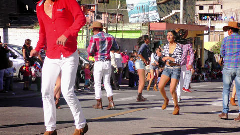 Dancing Group On The Streets Of Banos During 100th Anniversary Of Sagrado Corazo stock footage