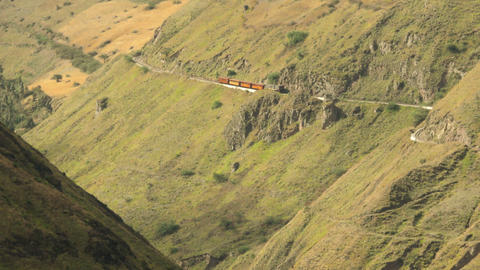 High altitude train in Ecuadorian Andes approaching Nariz del Diablo Footage