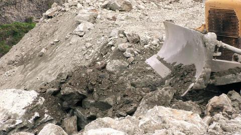 Bulldozer moving large quantity of loose rocks Footage