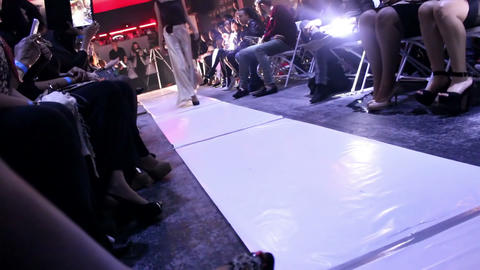 Model wearing design satin gown on the catwalk Footage