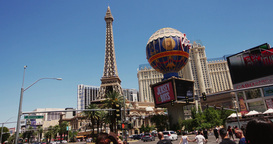 Steadicam Shot Of The Eiffel Tower In Las Vegas . The Road , The Car, And Turist stock footage