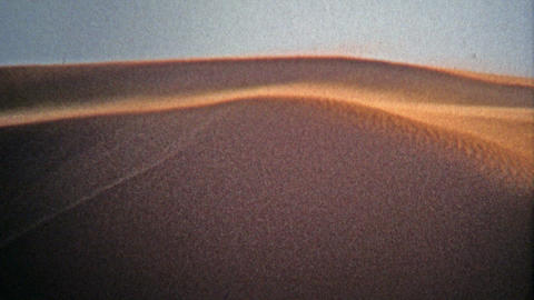 1972: Classic sand dunes attract thrill seekers as the wind picks up Footage