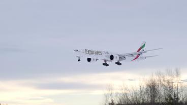 Emirates Boeing 777 arrival back light super slow motion Footage