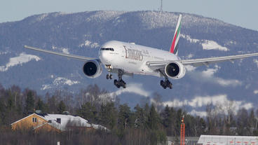 Emirates Boeing 777 Landing Beautiful Winter Scenery Super Slow Motion stock footage