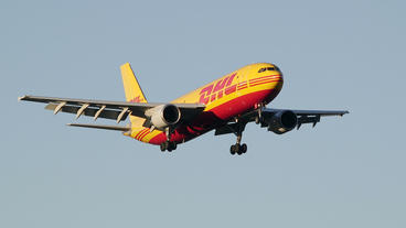 DHL Cargo Airbus A300 Arrival Early Morning Light Slow Motion stock footage