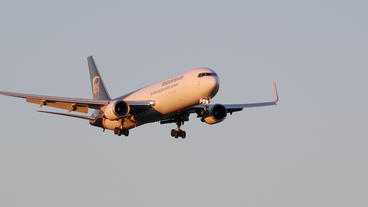 UPS cargo Boeing 767 arrival in beautiful morning light slow motion Footage