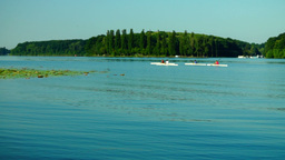 Young People Kayaking In The Lake. Holiday Activity Footage