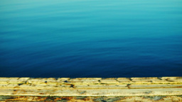 Wooden Pier And Indigo Water, Tilt. Holiday Landscape Footage