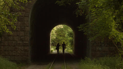 Romantic Couple Walking Through A Tunnel stock footage