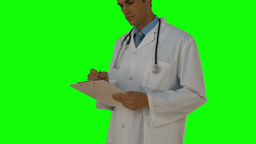 Young doctor writing on clipboard Footage