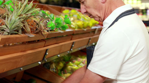 Senior worker stocking the vegetables in supermarket Footage
