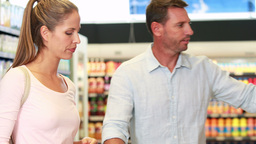 Couple shopping in grocery store Footage