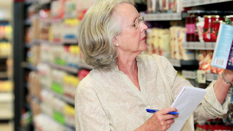 Senior woman shopping in grocery store Footage