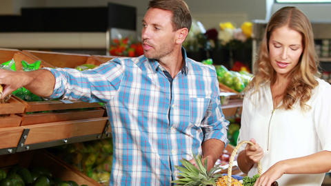 Happy couple shopping in grocery store Footage