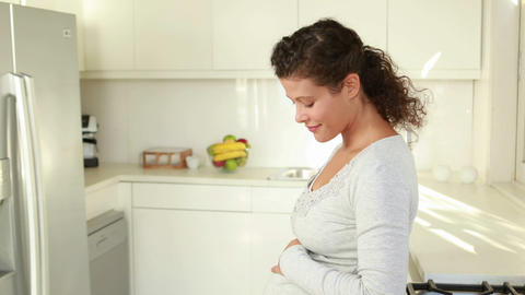 Pregnant woman in the kitchen Footage