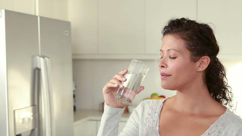 Pregnant woman drinking glass of water Footage