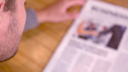 Man Reading Newspaper In Cafe stock footage