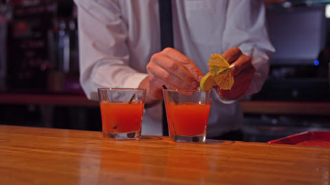 Bartender pouring cocktails on counter Footage