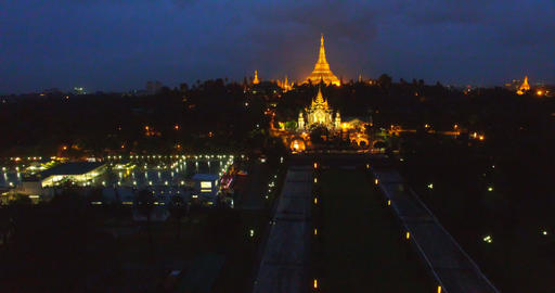 Night aerial 4k flight - forward and rising crane shot of Schwedagon pagoda Footage