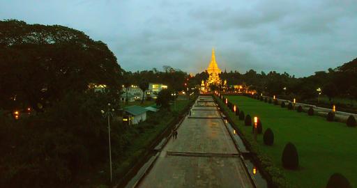 4k aerial - people square flight towards Shwedagon pagoda Live Action