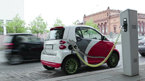 Electric car at charging station in the street Footage