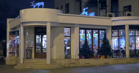 Cafe building with Christmas decoration at night Footage