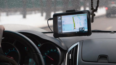 Driving a car with GPS device over dashboard Live Action