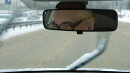 Senior man driving a car in winter Footage