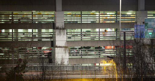 Timelapse of traffic near parking deck at night Footage