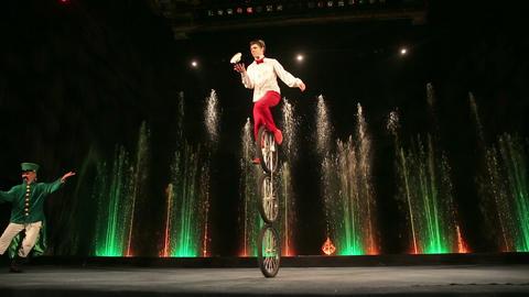 Balance-master performing on three wheeled cycle Footage