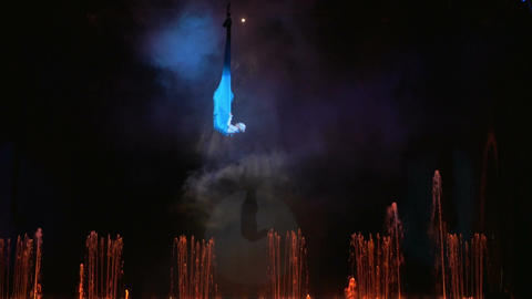 Aerial performance on the stage with fountains Footage