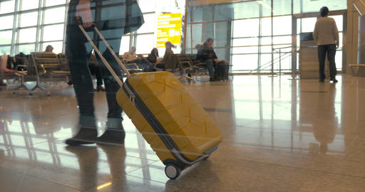 Walking with travel bag at the airport Footage