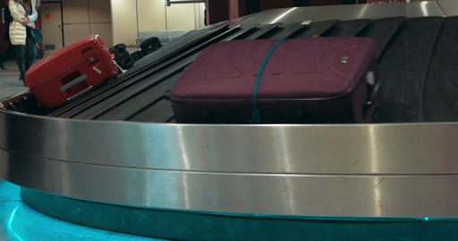 Suitcases on conveyor belt waiting for owners Footage