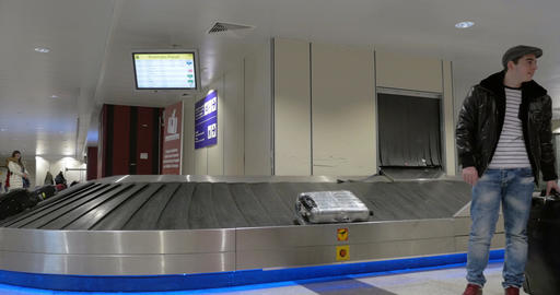 People in baggage claim area of airport Footage