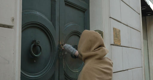 Woman opening entrance door and coming in Footage