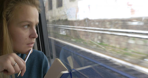 Woman making sketches during train ride Live Action
