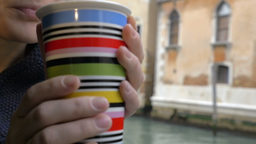 Woman drinking tea by the window with Venice view Footage
