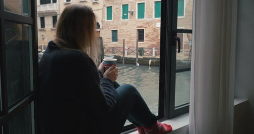 Woman drinking coffee and looking at Venice view Footage
