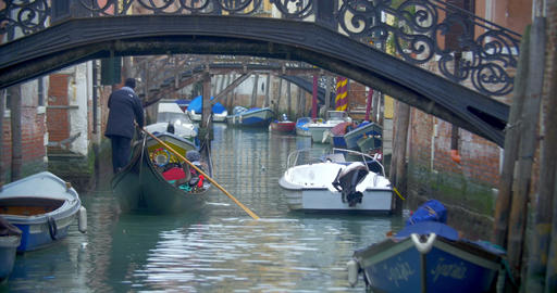 Gondola with tourists sailing on Venetian canal Live Action