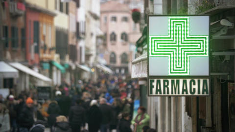 Pharmacy sign hanging in crowded street Footage