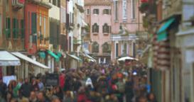 Crowd of people walking along Venetian street Footage