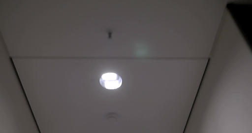 Walking through the hotel corridor, ceiling view Footage