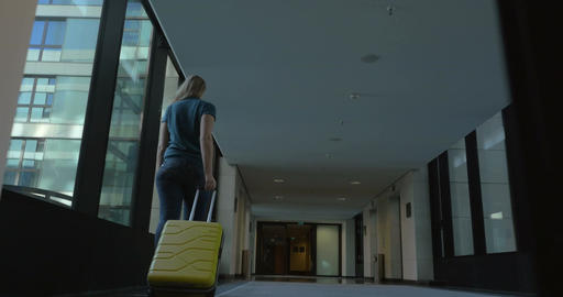 Woman with travel bag leaving hotel Footage