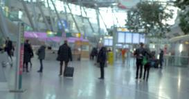 Passengers walking around big and light airport hall Footage