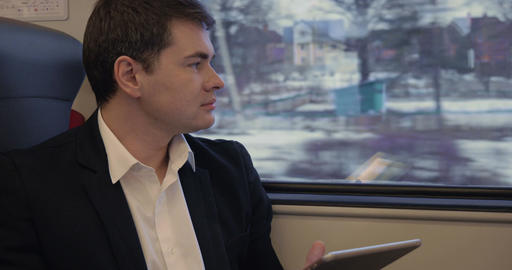 Young businessman working with pad in the train Footage