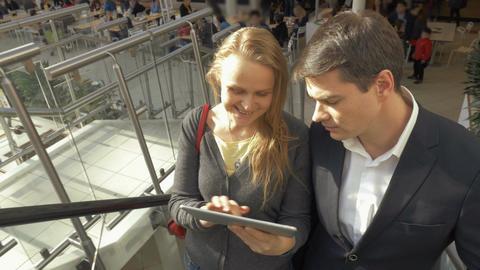 Businesspeople using pad on escalator Footage
