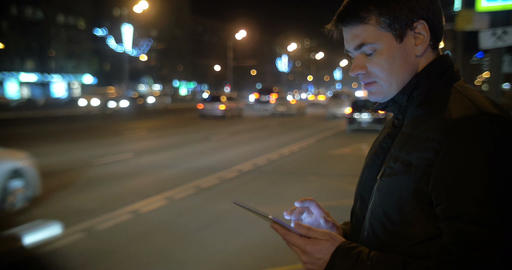Man using touch pad by the busy road in city Footage