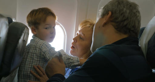 Grandparents and little grandson traveling by plane Footage