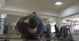 Men doing situps and bench press exercises Footage