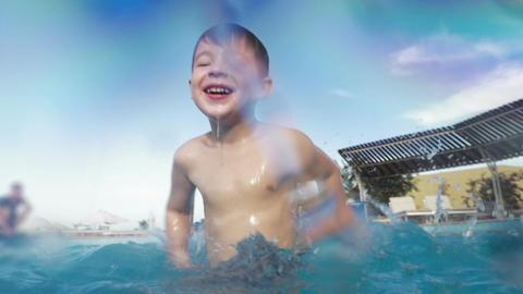 Boy having fun in the pool on resort Footage